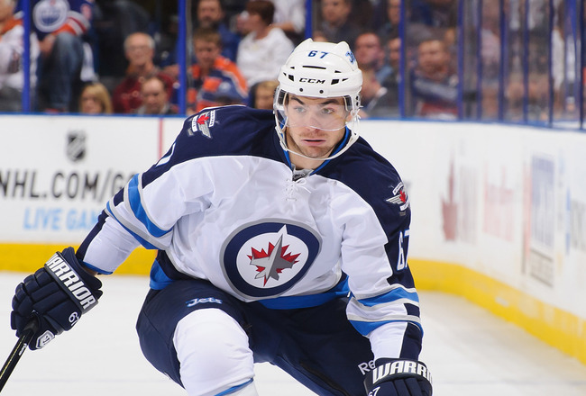 Hi-res-183929783-michael-frolik-of-the-winnipeg-jets-skates-against-the_crop_650x440