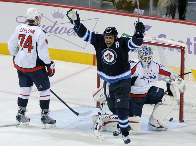 Hi-res-185605255-dustin-byfuglien-of-the-winnipeg-jets-throws-his-arms_crop_650