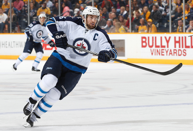 Hi-res-186300761-andrew-ladd-of-the-winnipeg-jets-skates-against-the_crop_650