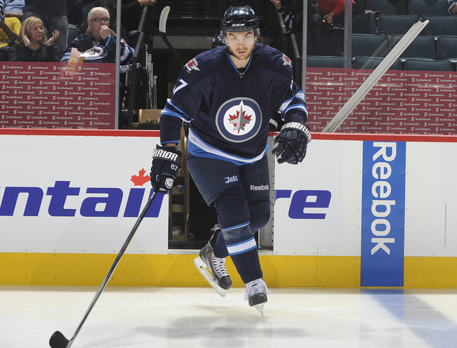 Hi-res-184780819-michael-frolik-of-the-winnipeg-jets-hits-the-ice-prior_crop_650