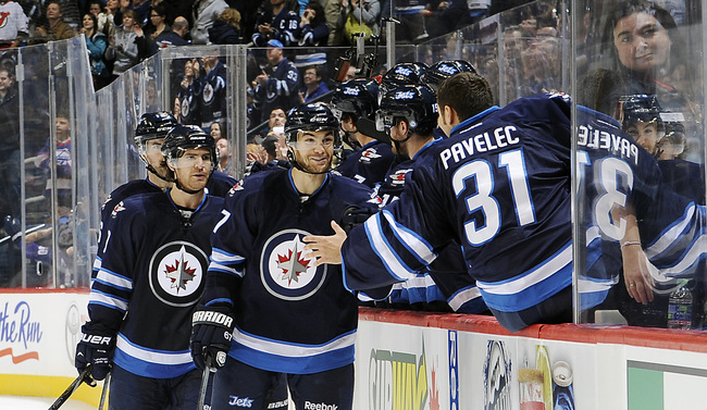 Hi-res-184430733-ondrej-pavelec-of-the-winnipeg-jets-leans-over-the_crop_650
