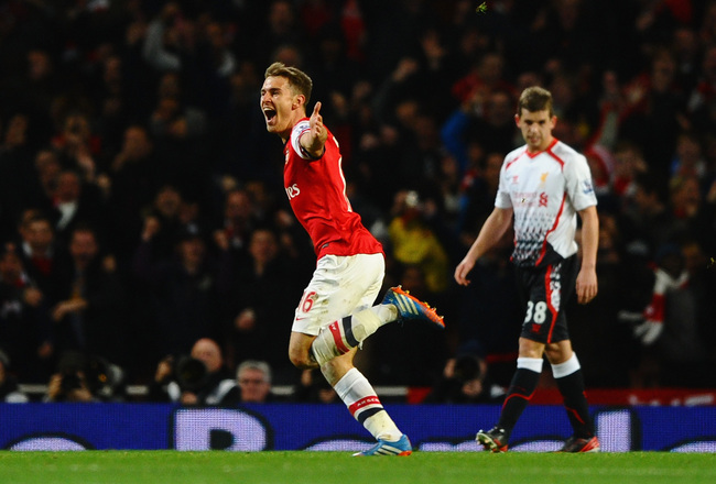 Hi-res-186637805-aaron-ramsey-of-arsenal-celebrates-scoring-their-second_crop_650x440