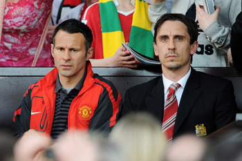 Hi-res-111927415-ryan-giggs-of-manchester-united-and-gary-neville-look_display_image