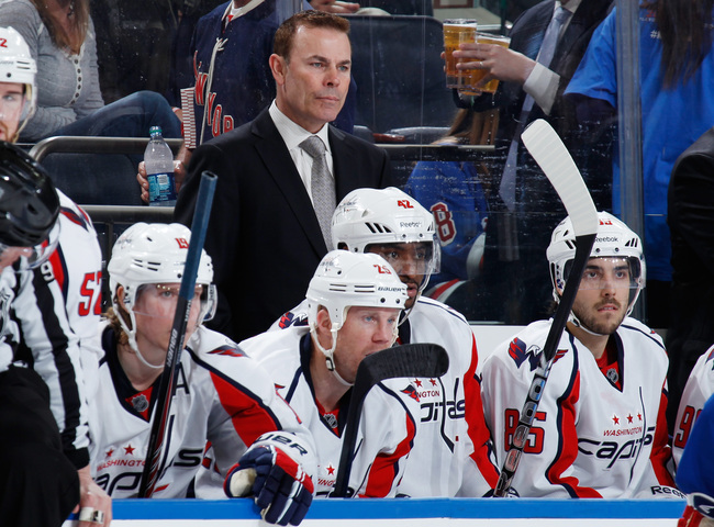 Hi-res-168198641-washington-capitals-head-coach-adam-oates-follows-the_crop_650