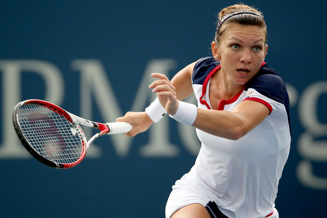 Hi-res-179363965-simona-halep-of-romania-looks-to-return-a-shot-during_crop_650