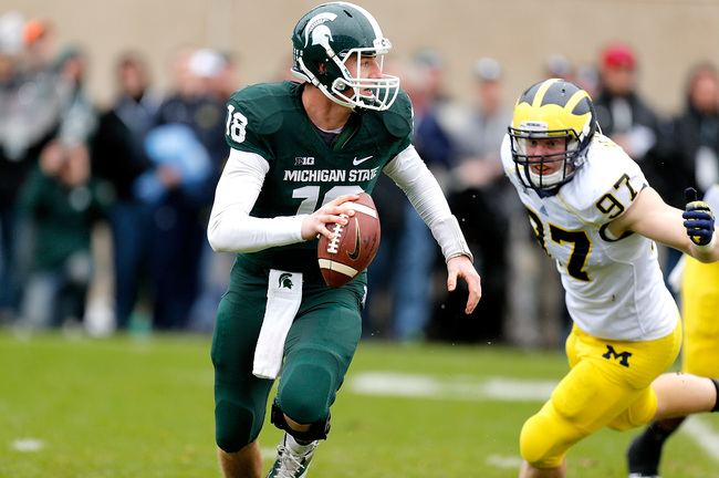 Hi-res-186642015-connor-cook-of-the-michigan-state-spartans-avoids-the_crop_650