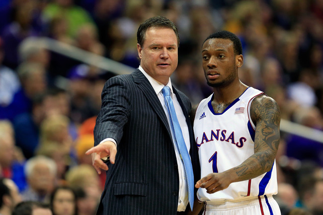 Hi-res-163823539-naadir-tharpe-of-the-kansas-jayhawks-talks-with-head_crop_650
