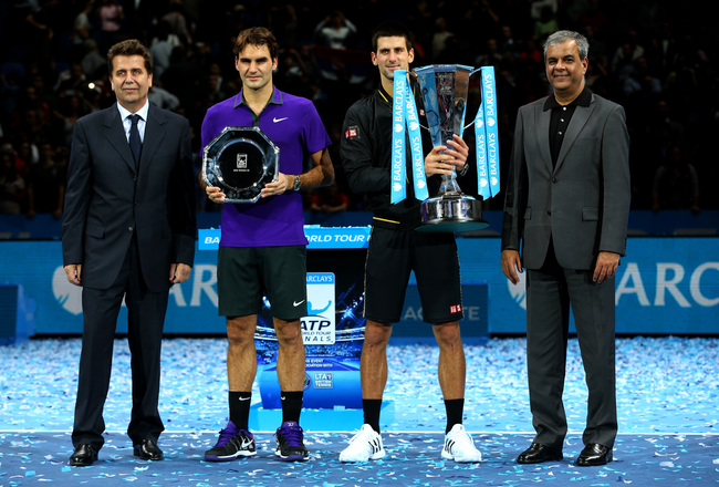 Hi-res-156273739-novak-djokovic-of-serbia-holds-the-trophy-next-to-ashok_crop_650x440