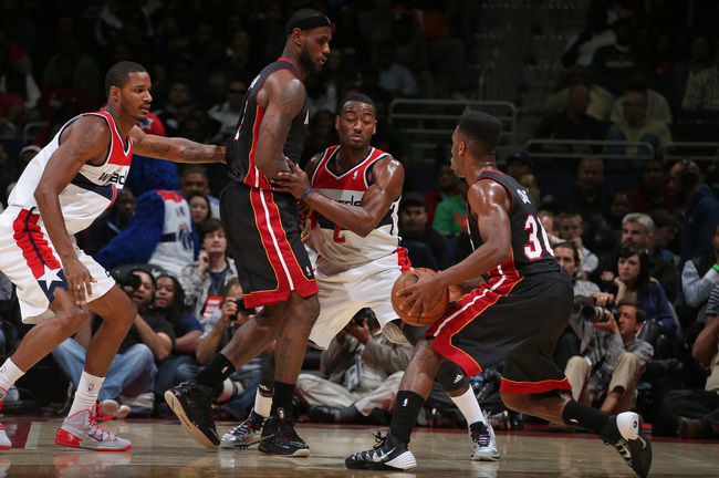 Hi-res-184713798-john-wall-of-the-washington-wizards-defends-against_crop_650