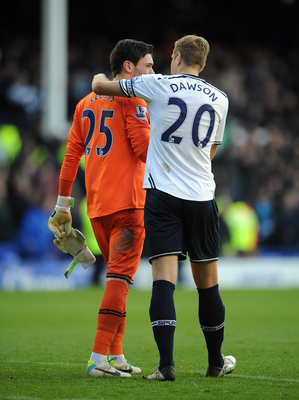 Michael Dawson checks on Hugo Lloris.