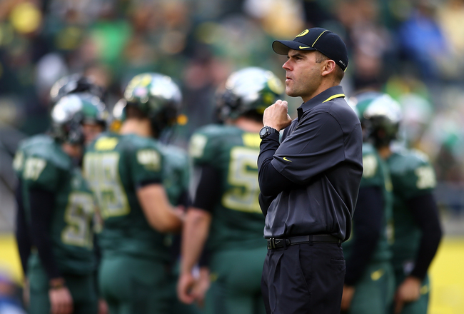 Hi-res-185964152-head-coach-mark-helfrich-of-the-oregon-ducks-watches_crop_650x440