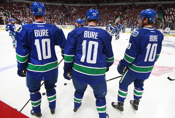 Hi-res-186648580-henrik-sedin-daniel-sedin-and-ryan-stanton-of-the_display_image