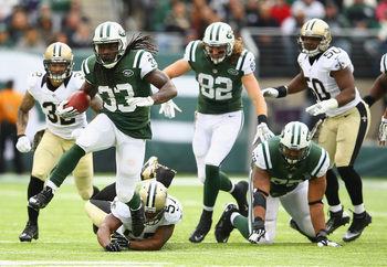 Hi-res-186717271-chris-ivory-of-the-new-york-jets-eludes-the-tackle-of_display_image