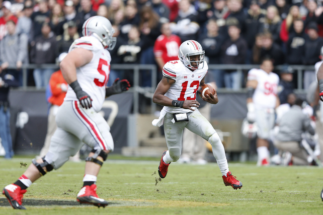Hi-res-186639953-kenny-guiton-of-the-ohio-state-buckeyes-runs-with-the_crop_650