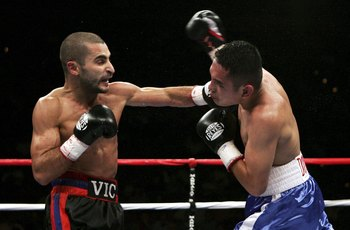 Hi-res-72114868-vic-darchinyan-lands-a-punch-against-glenn-donaire_display_image