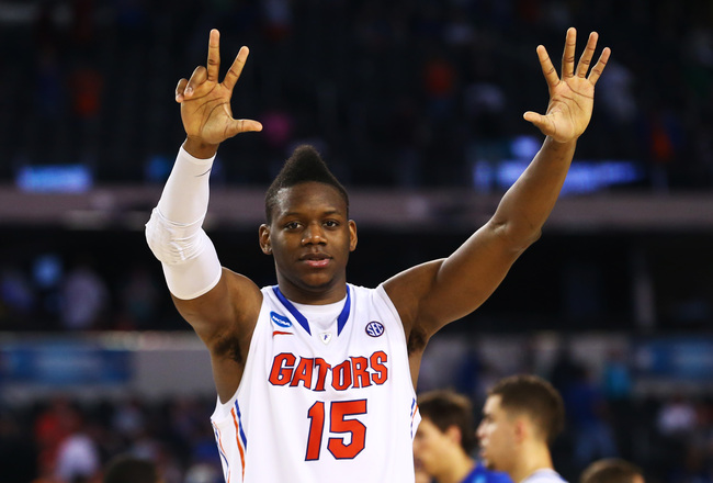 Hi-res-164970019-will-yeguete-of-the-florida-gators-celebrates-their-62_crop_650x440
