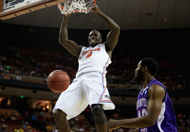 Hi-res-164344288-patric-young-of-the-florida-gators-dunks-the-ball_crop_650