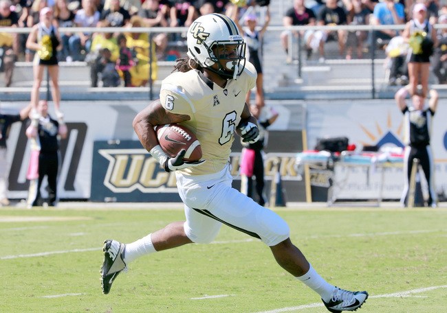 Hi-res-186098435-rannell-hall-of-the-ucf-knights-runs-for-yardage-during_crop_650