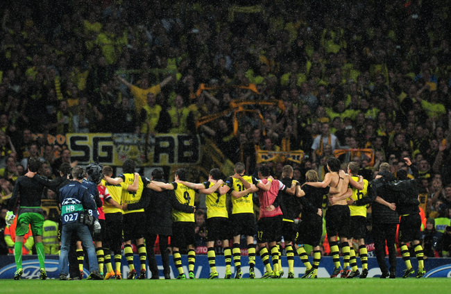 Hi-res-185587787-borussia-dortmund-players-celebrate-victory-at-the_crop_650