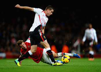 Hi-res-186640630-aaron-ramsey-of-arsenal-tackles-jordan-henderson-of_display_image