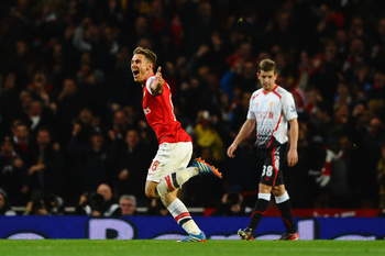 Hi-res-186637805-aaron-ramsey-of-arsenal-celebrates-scoring-their-second_display_image