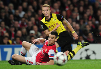 Hi-res-185625354-marco-reus-of-borussia-dortmund-and-laurent-koscielny_display_image