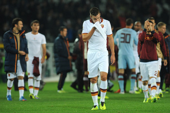 Hi-res-186727334-kevin-strootman-of-as-roma-looks-dejectied-at-the-end_display_image