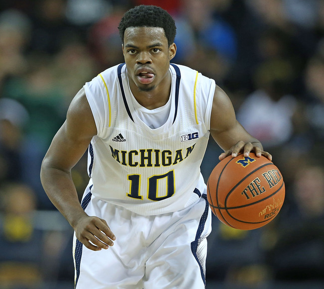 Hi-res-186897896-derrick-walton-jr-10-of-the-michigan-wolverines-brings_crop_650