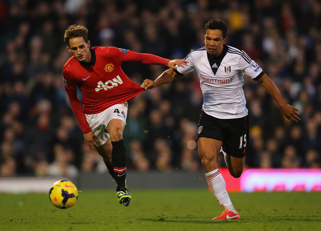 Hi-res-186629129-kieran-richardson-of-fulham-pulls-on-the-shirt-of-adnan_crop_650