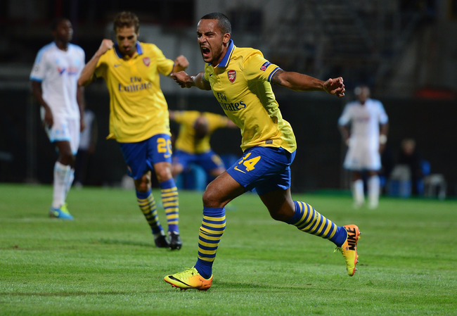 Hi-res-180963798-theo-walcott-of-arsenal-celebrates-his-goal-during-the_crop_650