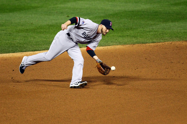 Hi-res-185976081-stephen-drew-of-the-boston-red-sox-fields-a-ground-ball_crop_650