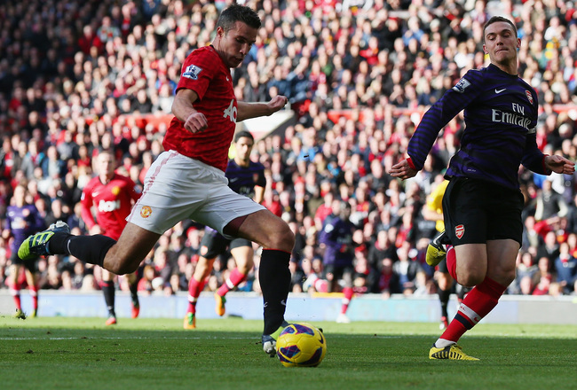 Hi-res-155342378-robin-van-persie-of-manchester-united-shoots-at-goal_crop_650x440