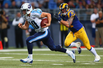 Hi-res-186727029-jake-locker-of-the-tennessee-titans-rushes-for-a_display_image
