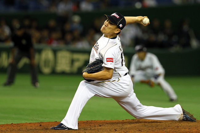 Hi-res-163569093-pitcher-masahiro-tanaka-of-japan-pitches-during-the_crop_650