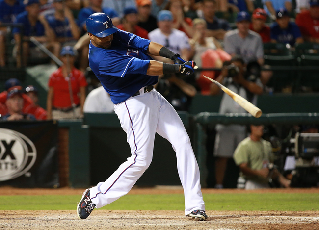 Hi-res-171950185-nelson-cruz-of-the-texas-rangers-breaks-his-bat-hitting_crop_650
