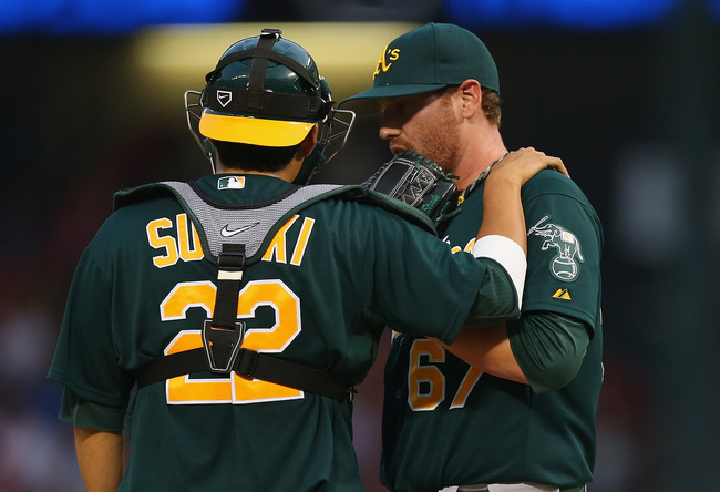 Hi-res-180501239-kurt-suzuki-of-the-oakland-athletics-talks-with-dan_crop_650