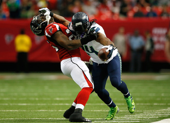 Hi-res-187601845-marshawn-lynch-of-the-seattle-seahawks-stiff-arms_display_image