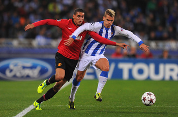 Hi-res-187018464-chris-smalling-of-manchester-united-battles-with_display_image