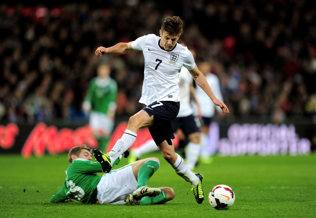 Hi-res-450601963-adam-lallana-of-england-is-tackled-by-toni-kroos-of_crop_650