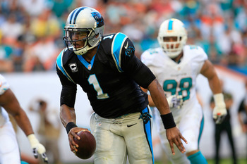 Hi-res-451771307-cam-newton-of-the-carolina-panthers-looks-to-pass-the_display_image