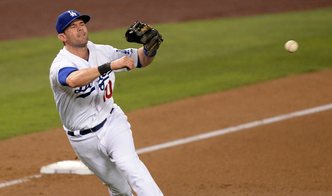 Hi-res-180353614-michael-young-of-the-los-angeles-dodgers-makes-a-throw_crop_650