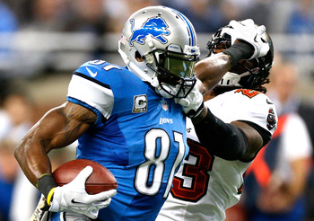 Hi-res-451753485-calvin-johnson-of-the-detroit-lions-stiff-arms-mark_display_image