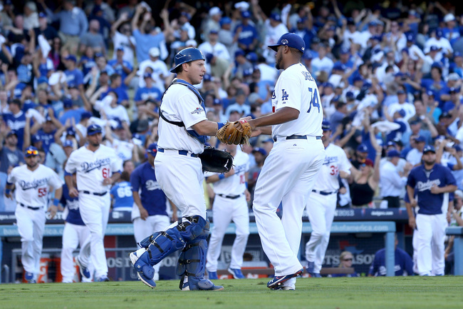 Hi-res-184798031-kenley-jansen-and-a-j-ellis-of-the-los-angeles-dodgers_crop_650