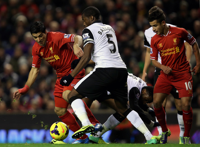 Hi-res-453583515-luis-suarez-of-liverpool-battles-with-sebastian-bassong_crop_650