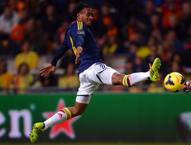 Hi-res-450581231-juan-cuadrado-of-colombia-jumps-for-the-ball-during-the_crop_650