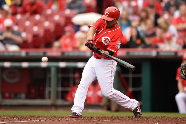 Hi-res-182322475-cesar-izturis-of-the-cincinnati-reds-hits-a-ground-rule_crop_650