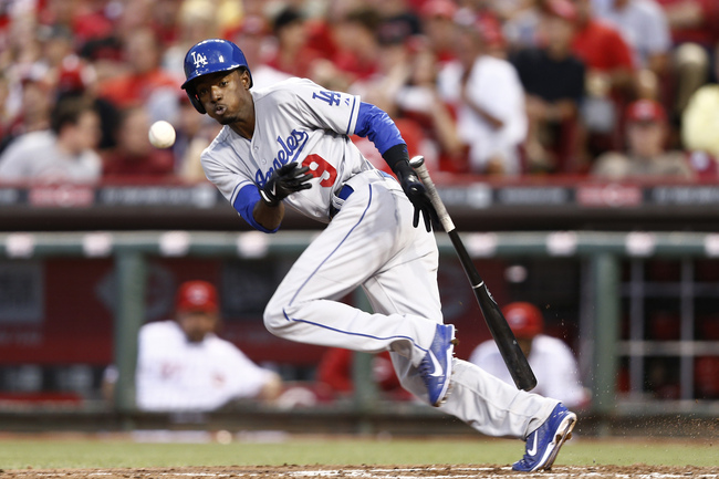 Hi-res-179754601-dee-gordon-of-the-los-angeles-dodgers-bunts-for-a-hit_crop_650