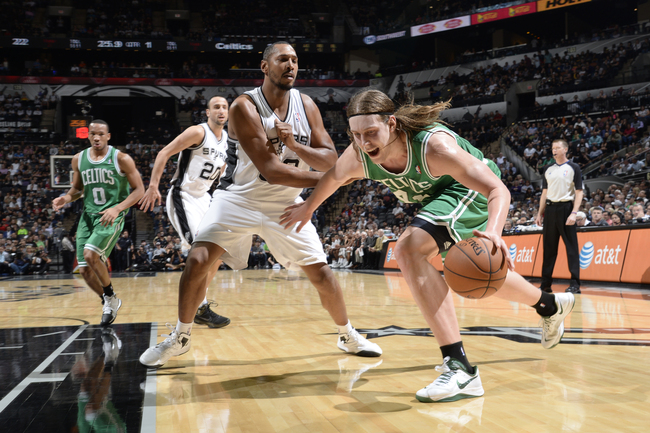 Boston Celtics' 5 New Years Resolutions Hi-res-450934159-kelly-olynyk-of-the-boston-celtics-drives-to-the-basket_crop_650