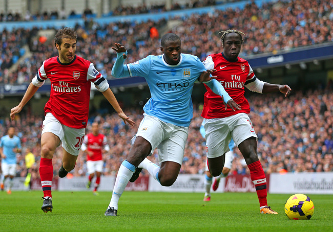 Hi-res-456514111-yaya-toure-of-manchester-city-is-closed-down-by-mathieu_crop_650