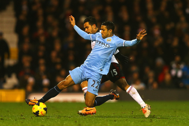Hi-res-458745283-kieran-richardson-of-fulham-and-gael-clichy-of_crop_650